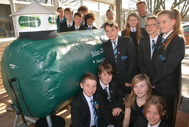 cullompton community college students show off their new Ridan food waste composter.