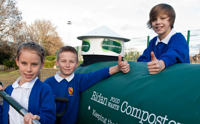 Schoolchildren with Ridan Composting Machine