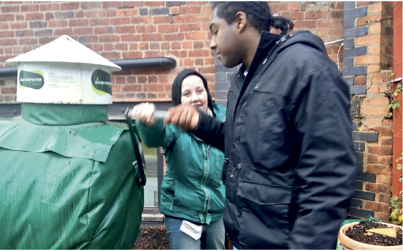 Students at Argent College operating a Ridan Composter